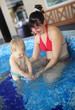 Mother play with her lovely child in jacuzzi