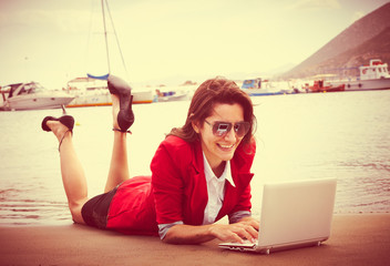business woman lying at beach