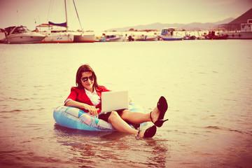 businesswoman floating in ocean