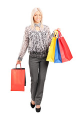 Fashionable woman carrying shopping bags