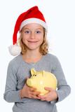 smiling girl with Santa- cap and piggy bank