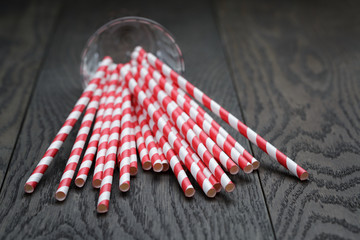 vintage paper straws in glass on wood table