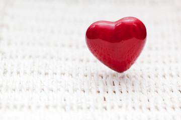 Red heart shape on wicker. Retro, rustic