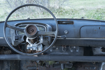 old abandoned car , dashboard and steering whee