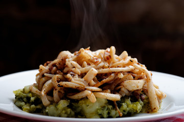 Grilled squid on sprouts