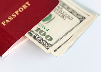 International passport and dollar bills