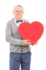 Senior gentleman holding a red heart