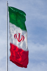 Iran Flag Waving in the Wind against Blue Sky with Copy Space