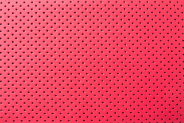 Red leather texture with perforated holes