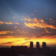 sunrise above city