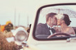 Bride and groom in a vintage car - 73879993