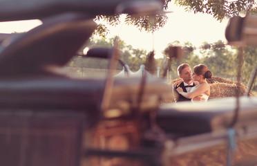 bridal couple sitting on hay