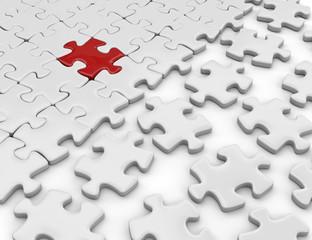 puzzule con tassello rosso di riferimento