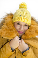 Beautiful fashionable young woman in winter clothes