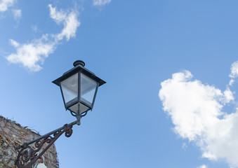 lamppost under a cloudy sky