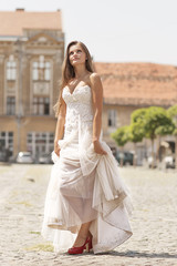 Beautiful sexy bride dress in city square place sunny day