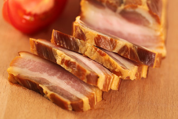 Delicious pork belly meat with tomatoes