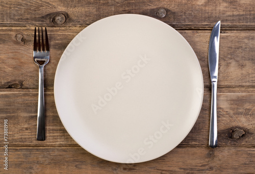 Empty plate on wooden background - 73881998