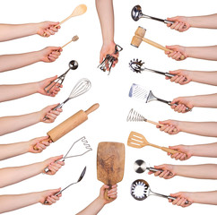 Woman holding kitchen utensils