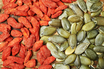 goji berry dry fruits and pumpkin seeds, on a wooden table