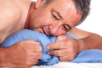 Man lying in bed and can not sleep