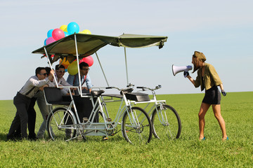 woman leading 4 guys on a quad bike