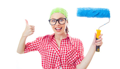 Surprised woman holding paint roller