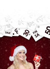 Woman in Christmas cap offer a special price on gift