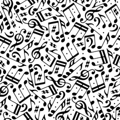 Vector black musical notes and treble clefs seamless pattern on