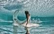 Beautiful woman underwater swiming