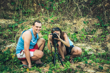 Nature photographers. Man and woman in jungle