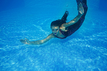 Beautiful woman swiming underwater