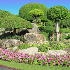 A beautiful park with trees and flowers.