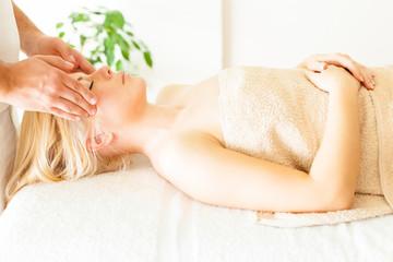Massaging Forehead