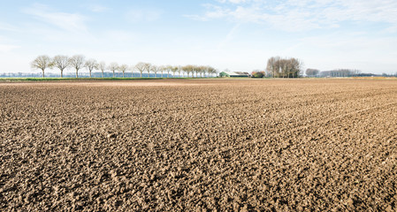 Plowed and cultivated clay soil waiting for winter