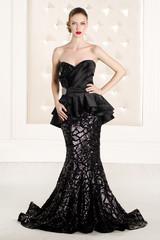 Gorgeous woman in black long dress