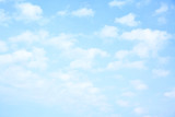 Light blue sky with clouds poster