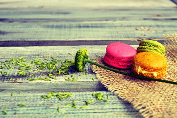 Colorful macaroons on a wooden background