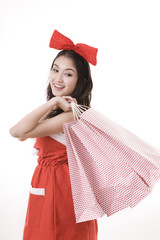 Christmas woman holding shopping bag with white background