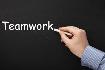 Writing the word Teamwork on a Blackboard