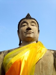 Stone statue of Buddha with blue sky