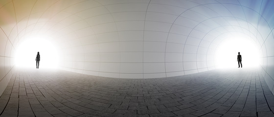 Couple standing at two ends of a tunnel