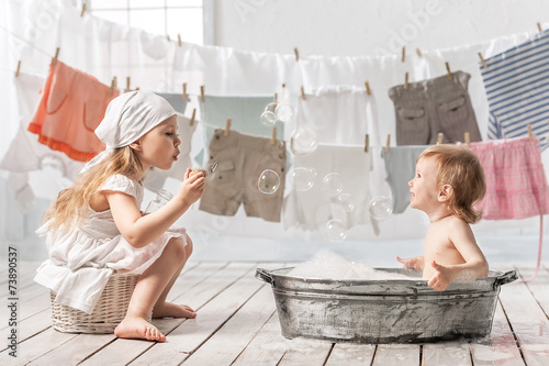 Bathing baby in the laundry room