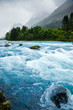 Milky blue glacial water of Briksdal River in Norway - 73891121