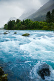 Milky blue glacial water of Briksdal River in Norway