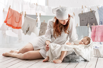 Mother with baby in the laundry