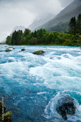 Spoed canvasdoek 2cm dik Rivier Milky blue glacial water of Briksdal River in Norway