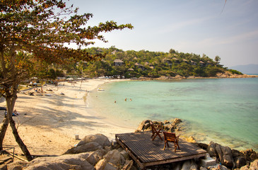 Two beach-chair beside the nice beach