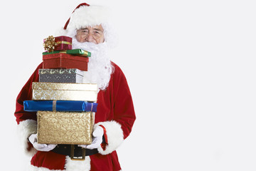 Santa Claus Holding Pile Of Gift Wrapped Presents