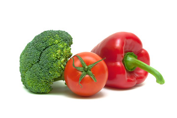 broccoli, tomato and bell pepper isolated on a white background